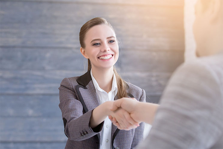 girl shaking hands in an interview