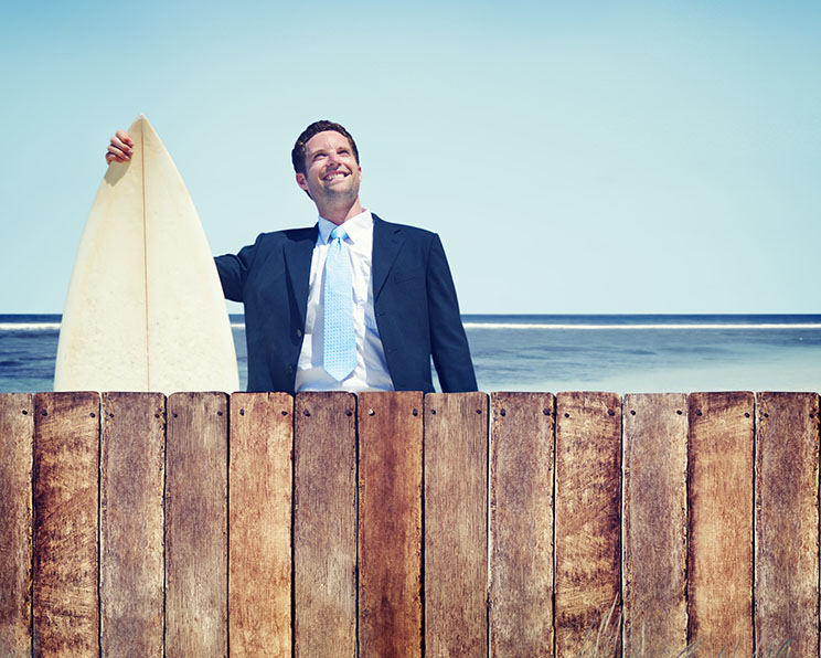 Business man in suit at the beach
